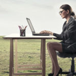 Lady sat at desk in field