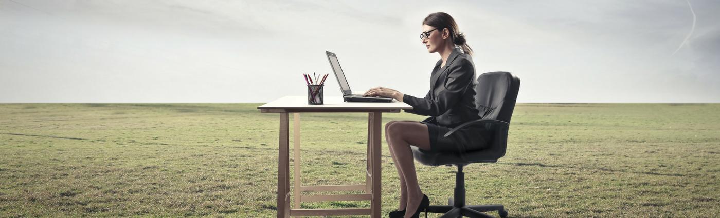 Lady sat at desk in field